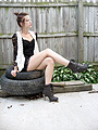 I'm drunk on momentum.  - Lace up combat boots, Weeken, White lace vest, Weeken, Black lace corset dress, Weeken, Kathryn Hilton, United States