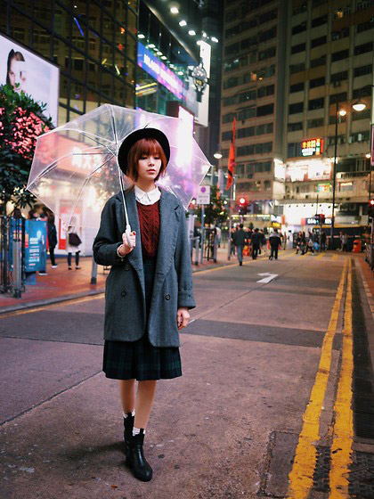 STREET SNAPSHOT - Oversize Blazer, Weeken, Sleeveless Sweater, Zara, Long Sleeves Shirt, WEEKEND, Checked Skirt, H&M, Boots, Zara, Black Hat, WEEKEND, Transparent Umbrella, Weeken, White Socks, Weeken, Una Yeung, Hong Kong